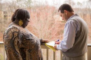 caregiver assisting patient